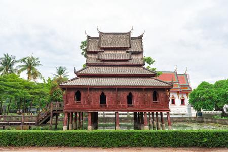 si: Ancient wooden monastery at wat Thung Si Muang in Ubon Ratchathani province, Thailand Stock Photo