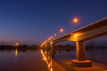 Bridge across the Mekong River at sunset. Thai-Lao friendship bridge at Nong Khai, Thailand Stock Photo