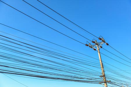 電柱と青空のワイヤ 写真素材