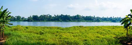 Panoramic river view in Keralas Backwaters, India. Stock Photo