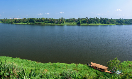 Panoramic river view and boat in Keralas Backwaters, India.