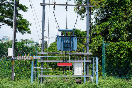 Electric transformer in side road at India.