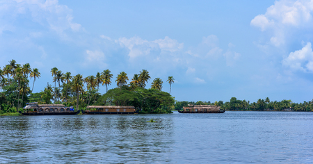Panoramic river view and traditional house boat in Keralas Backwaters, India.