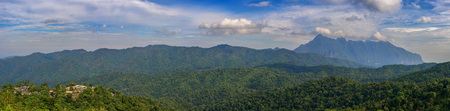 Panoramic mountains of Doi Luang Chiang Dao  and village in forest at Chiang Mai, Thailand. Фото со стока