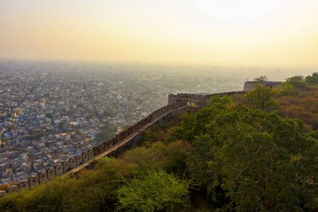 Beautiful sunset view from Nahargarh Fort stands on the edge of the Aravalli Hills, overlooking the city of Jaipur in the Indian state of Rajasthan, India.