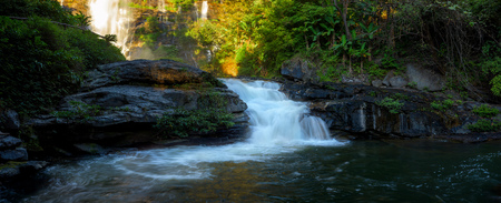 Panoramic beautiful deep forest waterfall in Chiang Mai, Thailand. Stock Photo
