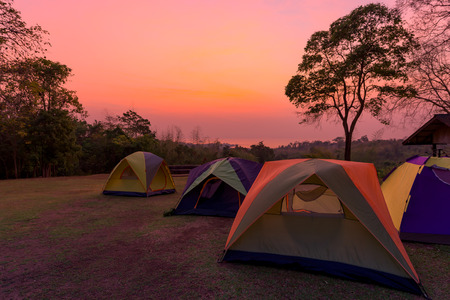 Tourist tent in camp among meadow in the mountain at sunrise