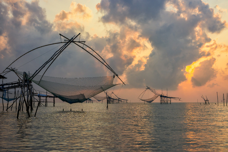 Flattering fish with sunrise sky at Phatthalung, Thailand.