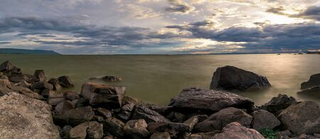 Panoramic sunset over the lake in nation park, Beautiful rock landscape with storm clouds, Thailand