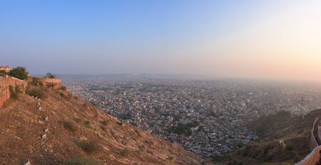 Panoramic beautiful sunset view from Nahargarh Fort stands on the edge of the Aravalli Hills, overlooking the city of Jaipur in the Indian state of Rajasthan, India.