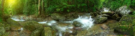 Panoramic beautiful deep forest waterfall in Thailand