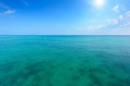 Tropical sea and blue sky with sun. Banco de Imagens