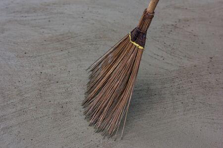 Coconut broom stick on the floor. Stock Photo