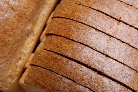 Loaf of bread, cut hunks photo