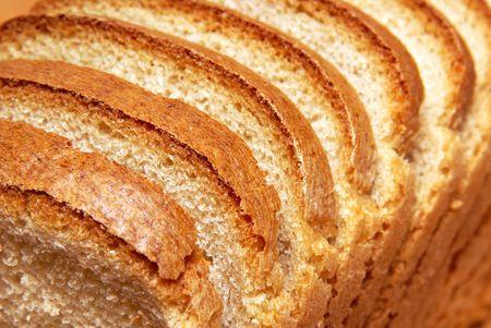 Loaf of wheat bread, cut hunks photo