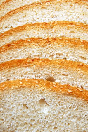 Loaf of white bread, cut hunks photo