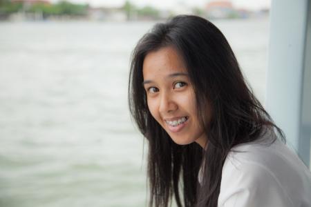 Asian girl to smile photo