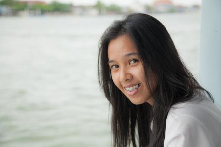 Asian girl to smile I photo