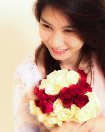sweet woman with flowers, close up photo