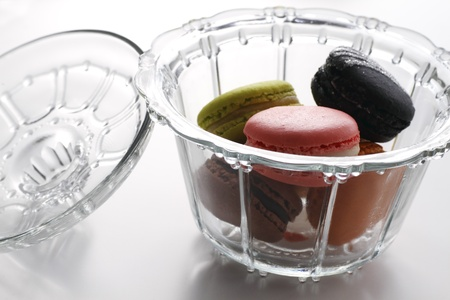 Macaron. Sweets in glass container photo