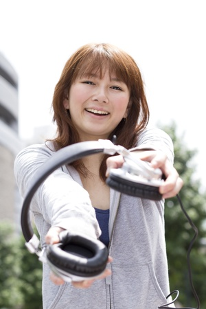Young woman in headphone photo
