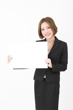Beautiful asian business woman holding a whiteboard.  photo