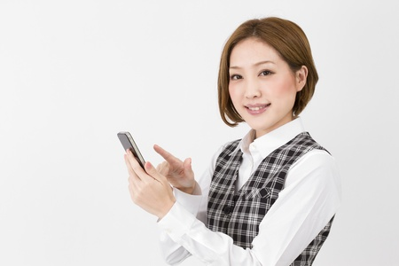 clearness: Asian woman using by mobile phone