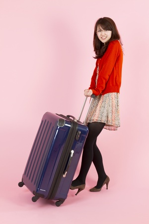 Beautiful asian woman traveling with bag  Stock Photo - 11600214