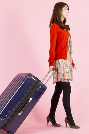 Beautiful asian woman traveling with bag Stock Photo - 11594472
