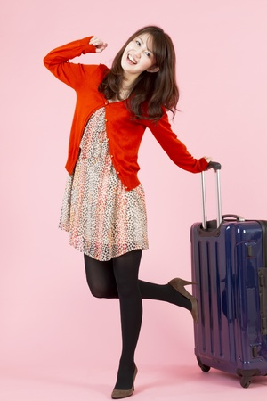 Beautiful asian woman traveling with bag  Stock Photo - 11600218