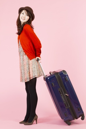 Beautiful asian woman traveling with bag Stock Photo - 11600215
