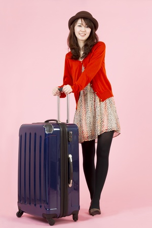 Beautiful asian woman traveling with bag Stock Photo - 11600213