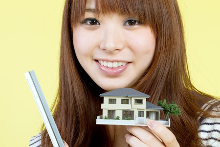 home buyer: Beautiful young woman with house model