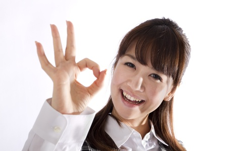 Beautiful business woman showing okay sign  photo