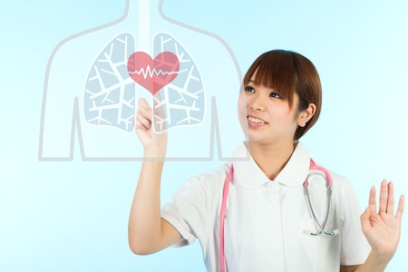Beautiful asian nurse and heart photo