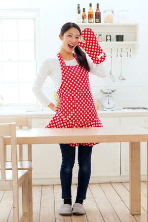 korean fashion: Beautiful apron woman in the kitchen