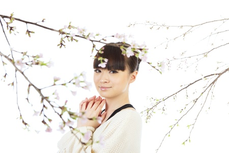 Beautiful woman and cherry blossom  photo