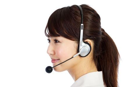 callcenter: Beautiful business operator. Portrait of asian woman. Stock Photo