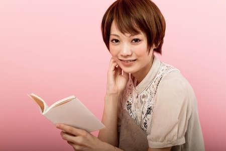 Beautiful asian woman reading a book  photo