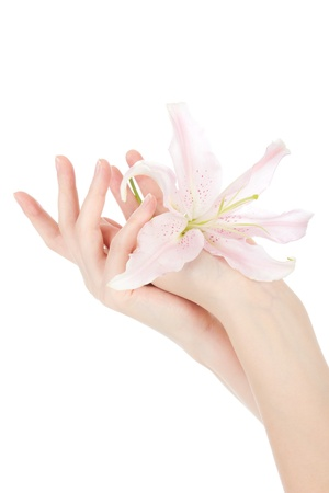 Beauty hands and lily 版權商用圖片