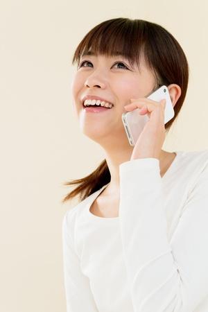 Beautiful woman using a mobile phone Stock Photo - 12628629