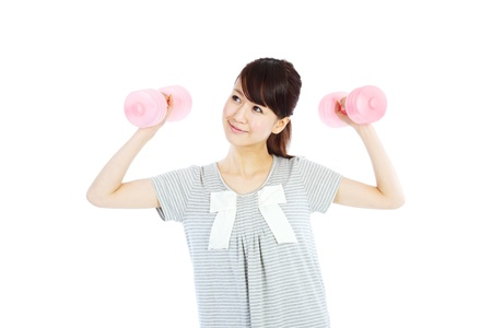Beautiful young woman with dumbbells in her hands  photo