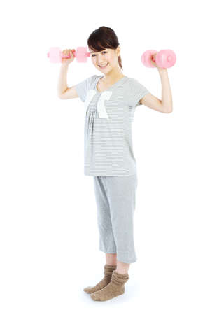 Beautiful young woman with dumbbells in her hands Stock Photo - 12628775