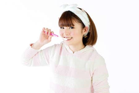 Beautiful young woman washing her face  Portrait of asian woman  photo