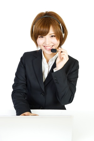 Beautiful business woman with headset  Portrait of asian woman  Stock Photo - 12631249