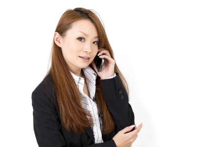 Beautiful asian business woman using a cellular phoen Stock Photo - 12631669