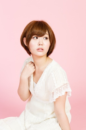 korean fashion: Beautiful young woman on pink background  Portrait of asian woman