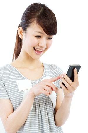 Young woman using by mobile phone Stock Photo - 12872954