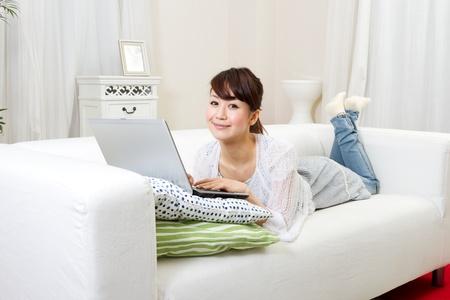 Beautiful woman relaxing in living room