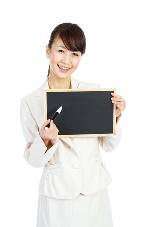Beautiful business woman with message board photo